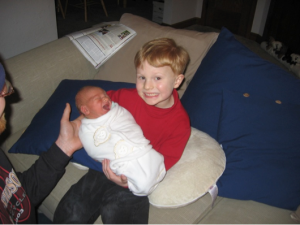 My son Sam helping dad with baby Ben